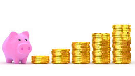 Piggy bank and is stacked coins